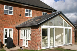 A brick and glass rear conservatory in Holmes Chapel by KJB Builders