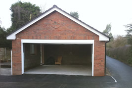Detached garage to side of house in Wilmslow by KJB Builders