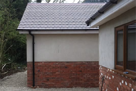Triple garage built in garden in Adlington by KJB Builders