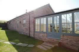 A barn conversion and renovation in Wild Boar Clough by KJB Builders