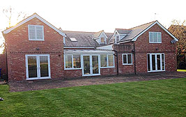 A conversion from a bungalow to a large detached house in Lymm