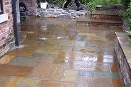 Patio landscaping to rear in Alderley Edge by KJB Builders