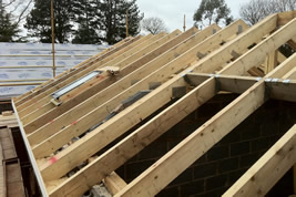A timber roof structure in Adlington by KJB Builders